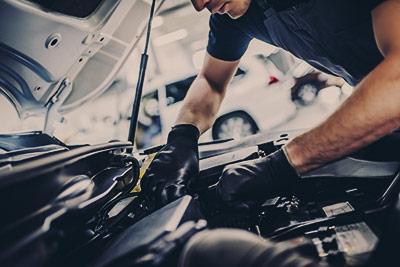 Mechanic checking the engine - Car Servicing Leighton Buzzard